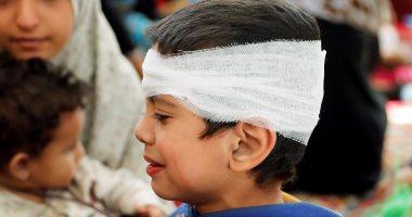بالصور.. مئات المدنيين يفرون من جحيم الحرب فى مدينة الرقة السورية
