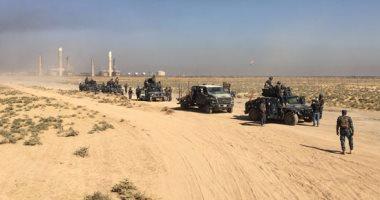 الدفاع العراقية: ضبط مخبأ أسلحة وعبوات ناسفة فى الموصل