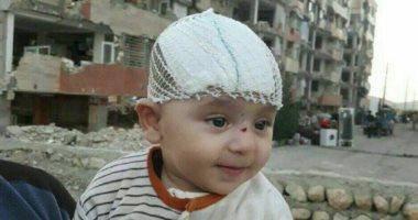معجزة إلهية..العثور على طفل على قيد الحياة تحت أنقاض زلزال إيران بعد 3 أيام 201711160423382338.j