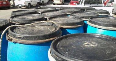 صور.. ضبط سيارة تحمل 1500 لتر لبن داخل براميل مواد كيماوية ببورسعيد
