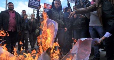 فلسطينيون يحرقون صورة ترامب فى مسيرات منددة بقرار نقل سفارة أمريكا للقدس