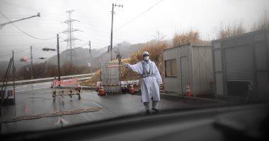 صور.. اليابان تبنى جدارا بارتفاع 12 مترا لمنع وصول الفيضان للمناطق السكنية