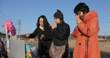 ورود وشموع وصلوات لإحياء الذكرى السابعة لكارثة 2011 النووية باليابان