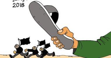 """طوابير الناخبين تسحق الإرهابيين.. بكاريكاتير """"اليوم السابع"""""""
