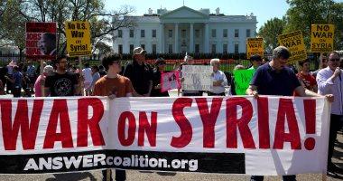 أمريكيون يتظاهرون خارج البيت الأبيض ضد الضربة الجوية على سوريا