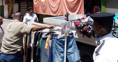 إزالة إشغالات وإغلاق محلات مخالفة في حملة مرافق بالجيزة