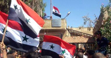 صور.. علم سوريا يرفرف فى درعا بعد سيطرة الجيش على المدينة