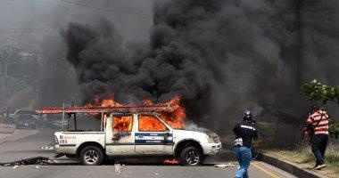 صور.. تواصل الاشتباكات وأعمال العنف فى هندوراس احتجاجا على ارتفاع الأسعار