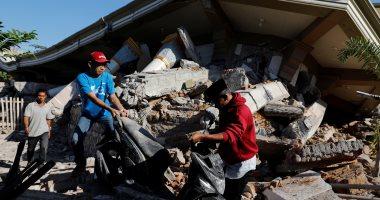 توقف الحياة العامة فى إندونيسيا بعد زلزال راح ضحيته 98 شخص