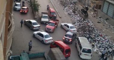 15 صورة ترصد انتشار القمامة بالشوارع الرئيسية فى إمبابة