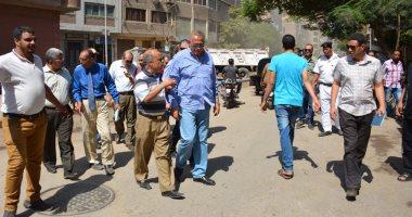 صور.. محافظ الجيزة يقود حملة لنظافة شارع الأقصر فى إمبابة