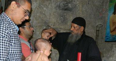 """""""اليوم السابع"""" يرصد تعميد الأطفال فى بمولد السيدة العذراء بدير درنكة بأسيوط"""