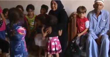 شاهد.. جدة عراقية ترعى 22 حفيدا قتل تنظيم داعش آباءهم