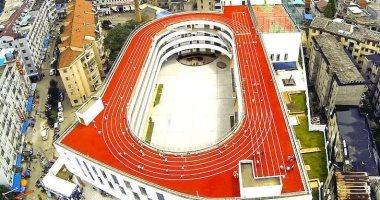 إبداع ليس له حدود مضمار للجرى مصدر إلهام لتصميم فريد لمدرسة بالصين