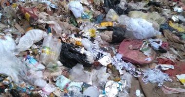 قارئ يشكو انتشار القمامة بأرض فضاء بشارع الدكتور فؤاد سعيد بالعمرانية الغربية