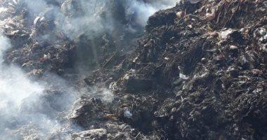صور..أهالى عزبة ابو خليل يشكون من حرق القمامة يوميا