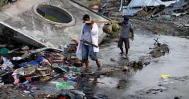 الإندونسيون يتحدون غضب الطبيعة ويعيدون الحياة لمناطق الزلزال وتسونامى