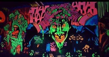 طالب هندسة يبدع فى رسم الجرافيتى على الحوائط والمحلات وجدران المدارس