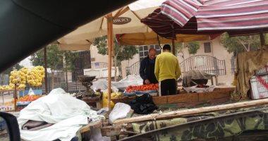 قارئ يشكو من وجود سوق عشوائى بمنطقة المنهل فى مدينة نصر.. صور