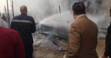 صور.. 3 سيارات إطفاء للسيطرة على حريق بجراج فى شبرا الخيمة