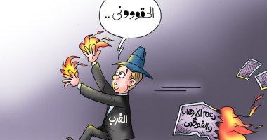"""الغرب ينكوى بنار تمويله للإرهاب فى كاريكاتير """"اليوم السابع"""""""