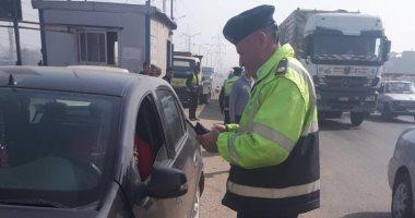حملات مرورية بمحاور القاهرة والجيزة لرصد المخالفين لقواعد المرور