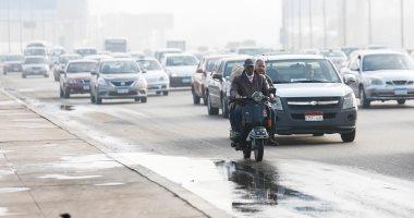 بالجاكيت والكوفية.. المصريون يواجهون برد الشتاء والمطر