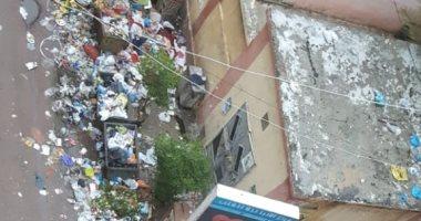 قارئ يشكو من انتشار القمامة بشارع سوق شيديا بالأسكندرية