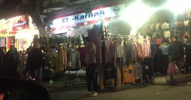 """عروض المحلات تقتحم نصف شارع أحمد عرابى بعين شمس.. وقارئة: """"أين الرقابة؟"""""""