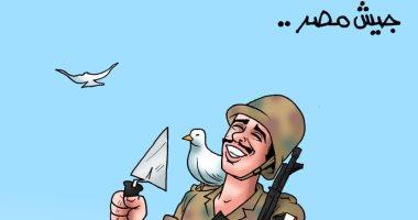 """يد تبنى وأخرى تحمل السلاح بكاريكاتير """" اليوم السابع """""""