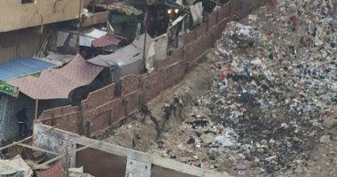 شكوى من انتشار القمامة والباعة الجائلين بنهاية مصطفى النحاس بمدينة نصر