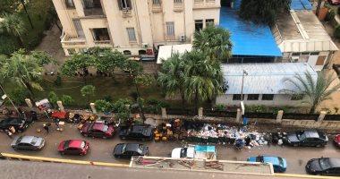 شكوى من تراكم القمامة بجانب سور كلية الفنون الجميلة فى الإسكندرية