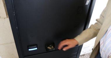 """صور.. """"المالية"""" تجرى تشغيلا تجريبيا لماكينة جديدة لتغيير العملات الورقية لمعدنية"""