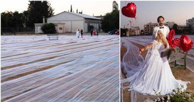 """""""عروسة"""" قبرصية تدخل موسوعة جينيس بأطول طرحة فى العالم.. صور"""