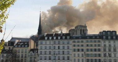 صور.. انهيار برج كاتدرائية نوتردام جراء الحريق