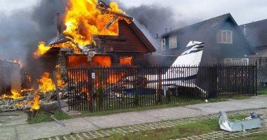 صور.. مصرع 6 أشخاص بعد سقوط طائرة على مبنى سكنى فى تشيلى