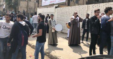 ناخبون يستعينون بالمزمار البلدى للحث على المشاركة بالاستفتاء بمدينة نصر