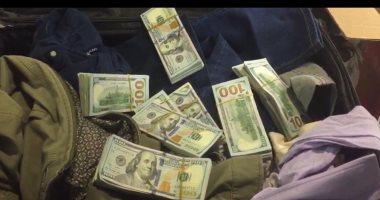 ضبط راكب بالمطار حاول تهريب 70 ألف دولار أمريكى إلي دبي