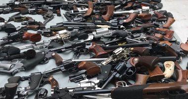 القبض على 14 متهما بحوزتهم أسلحة وذخيرة بدون ترخيص فى الجيزة