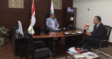 لقاء رئيس هيئة البريد ومستشار وزارة التخطيط