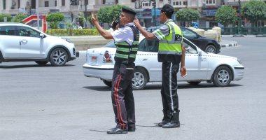 """""""رجال المرور"""".. جنود مجهولون يتحملون حرارة الشمس لخدمة المواطنين (صور)"""