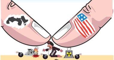 كاريكاتير يظهر ضغط العالم على إيران لتغيير سياستها العدوانية