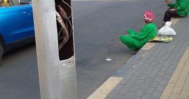 """صور.. """"أعمدة الموت"""" تنتشر فى شارع البطل أحمد عبد العزيز التابع لحى الجيزة"""