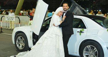 أول فوتوسيشن لعروسين على كوبرى تحيا مصر بمحور روض الفرج فى العيد