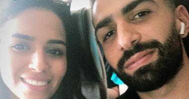 أسامة إبراهيم فى مطار القاهرة استعداداً لرحلة شهر العسل.. صور