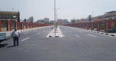 تخطيط الشوارع ودهان الأرصفة بمحيط استاد القاهرة استعدادا لبطولة أفريقيا