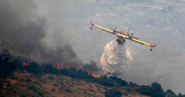 الطائرات تشارك رجال الإطفاء للسيطرة على حرائق غابات جزيرة إيفيا اليونانية