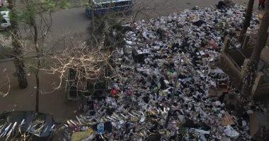 قارئ يشكو من انتشار القمامة بشارع عزبة المفتى بمنطقة إمبابة