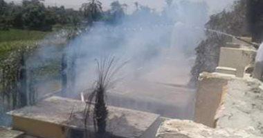 السيطرة على حريق أشجار ومخلفات زراعية بجوار مدرسة بإسنا