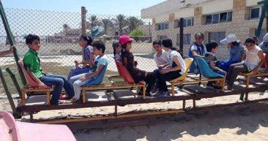 أهالى شمال سيناء يواصلون الاحتفال بالعيد فى الحدائق وعلى رمال الشاطئ.. صور